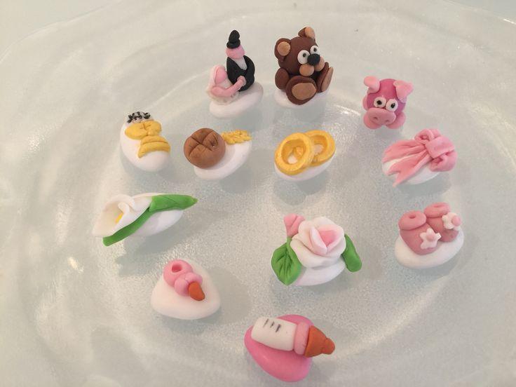 Confetti per nascita , prima comunione, matrimonio... decorati con pasta di zucchero.