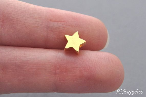 925 Sterling Silver Star Charm Gold Plated, Star Pendant, Silver Star, Little Star, Tiny Star, Sliver Charm, Jewelry making, Craft Tools, Silver Pendant, Little Silver  Plated- The product is covered with 24 carat gold. The product is coated with two layers of gold: the backing layer and a terminal, which makes the element more sturdy.  > Material: 925 silver plated with 24 carat gold > Size: 7,7 x 8 mm (0,30 x 0,31 inch) >The size of hole: 2,5 mm (0,10 inch) > Thickness: 3.5 (0,14inch)…