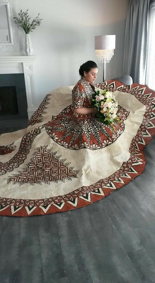 Real tapa wedding dress with Tongan artwork. Designed by Lua's Island Fashion.