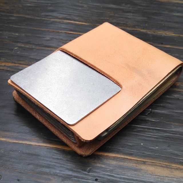 Someone basically asked: how small can we make the #stitchlesswallet and still have the backslot and cash? Shown here with 8 bills and a stack of stainless steel cards. 2-5/8 x 3-5/8 inches.  Of course we can make without the backslot but this small, the backslot needs to be off center.  Thin #hermannoakleather #Wallets #minimalistdesign #minimalistwallet #madeinusa #madeinminnesota #mensaccessories