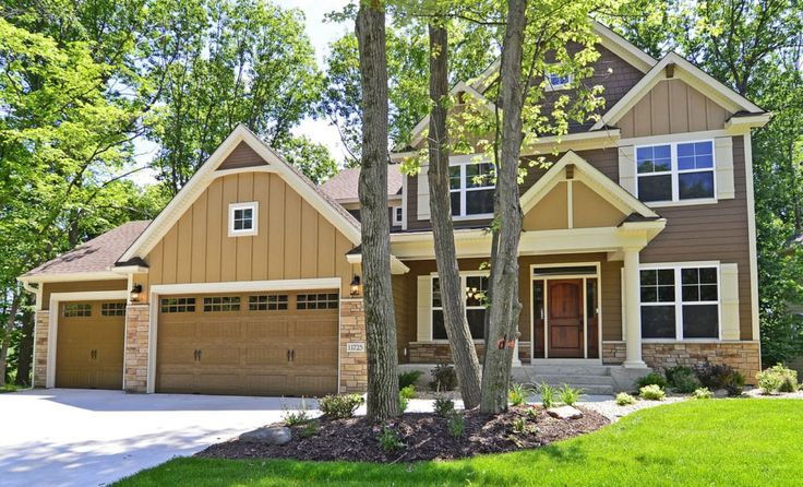 I like the single garage door on the left and set back a little and the higher roof over the double garage door.