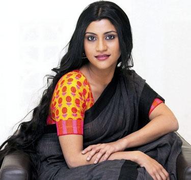 Konkona is surely Nandita Das' successor as the nation's sexiest dusky saree wearer.