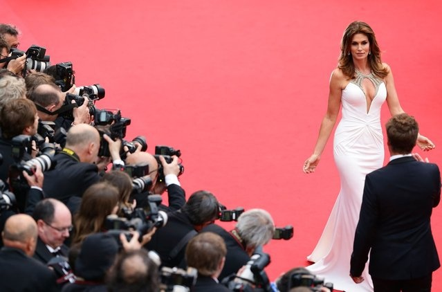 """Cindy Crawford attends the Opening Ceremony and """"The Great Gatsby"""" Premiere during the 66th Annual Cannes Film Festival at the Theatre Lumiere on May 15, 2013 in Cannes, France. (Photo by Vittorio Zunino Celotto/Getty Images)  http://avaxnews.net/fact/Cannes_2013_and_The_Great_Gatsby_Premiere.html"""