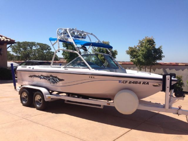 24 feet  2005 Correct Craft Super Air Nautique Ski and Wakeboard Boat , White / Blue Graphics, 248 hours for sale in Lincoln, CA