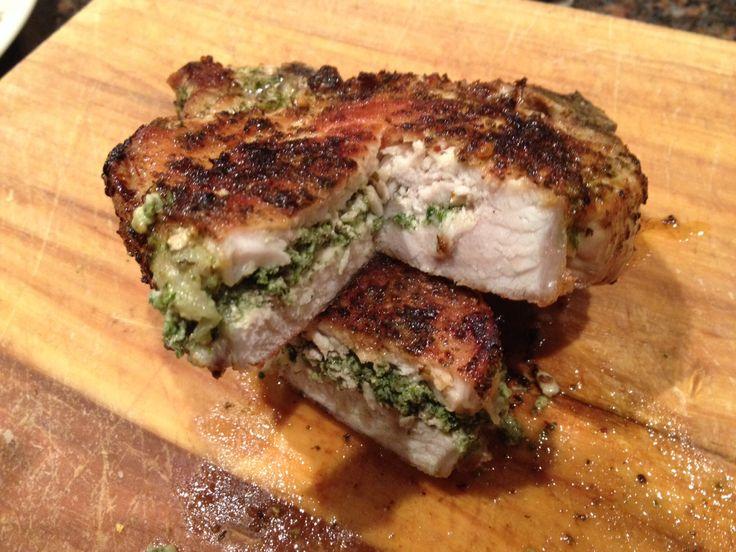 Stuffed bone-in pork chop with kale pesto and fontina cheese.