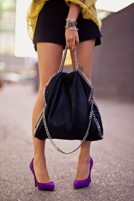 Forget the bag, look at the purple heels!