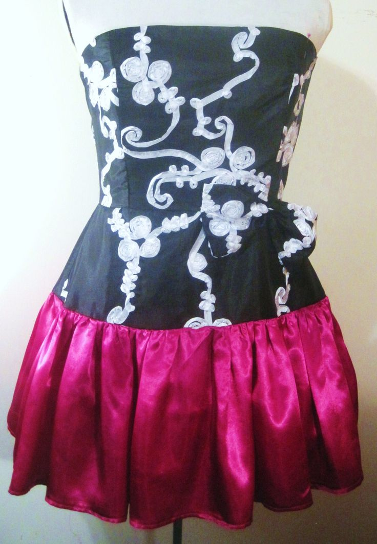 La Diva Dress. Strapless bodice and hip of skirt are black and white ribbon rosette taffeta. Bottom of skirt is magenta satin. Hot pink crinoline is sewn into lining.