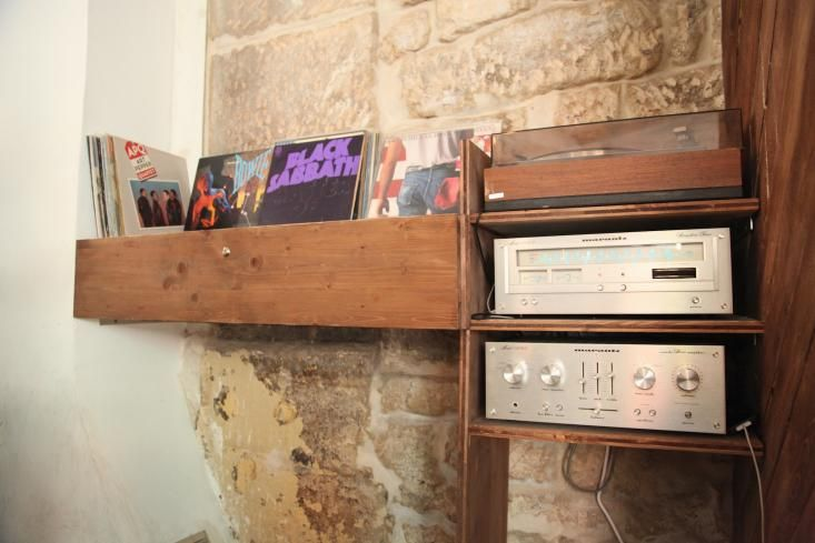 A vintage stereo setup is matched with vintage LPsLe Mary Celeste in the Marais in Paris, Remodelista