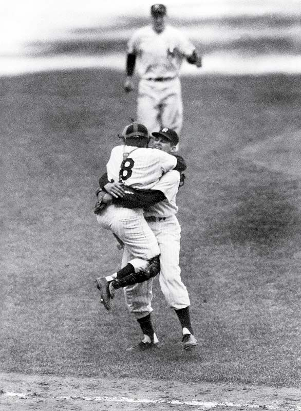Yogi Berra leaps into Don Larsen's after he successfully throws a perfect game against the Brooklyn Dodgers in Game 5 of 1956 World Series.