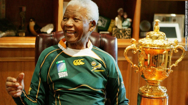 Mandela poses with the Webb Ellis Cup during the Springboks rugby teams visit to his Johannesburg home on October 27, 2007. South Africa became the holders of the cup after defeating England in the 2007 Rugby World Cup Final.