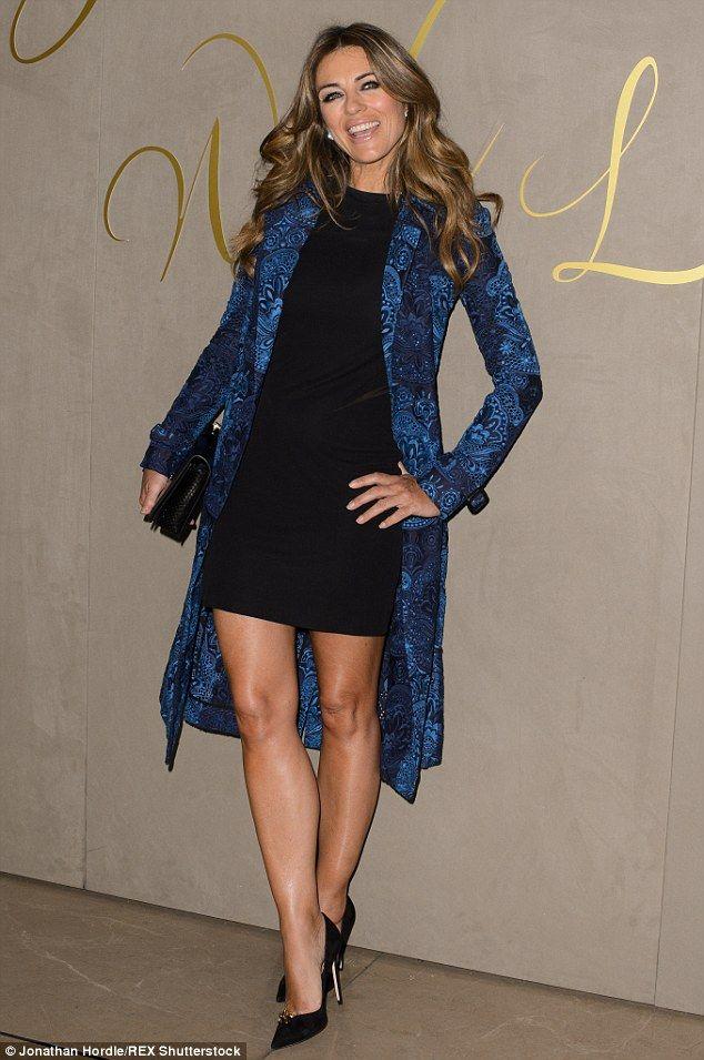 Elizabeth Hurley Showcases Her Enviable Legs In A Black