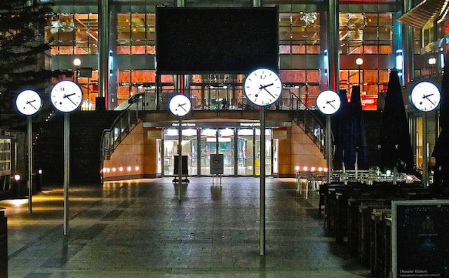 "After a few pints, we reckon these six CLOCKS in Canary Wharf get confusing. Always imagined they had something to do with different financial trading centres in time zones around the world. Actually an art installation, imaginatively named ""Six Public Clocks"", by Konstantin Grcic, they have been in situ since 1999. Design is based on iconic Swiss railway clock. On each of  12 clock faces (each clock is double sided) hands are in same position, but each one has a different number on it's…"