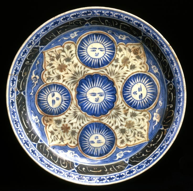 Fritware dish, painted in blue and black and with a red and a green slip under a transparent glaze Iran, Kerman; dated 1084 H = 1673 H: 6; Diam: 36 cm