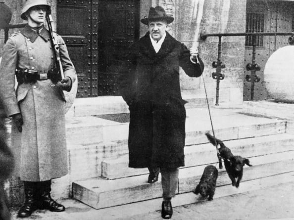circa 1932: German soldier and politician General Kurt Von Schleicher (1882-1934) walking his dogs. The Chief of Staff of the Germany Army in the first world war, he and his wife were executed by the Nazis on trumped up charges of treason. (Photo by Keystone/Getty Images)