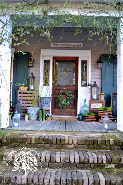 We love the look of this cottage front porch in spring. Brick steps backed up to a wooden porch gives this walk up a vintage feel. Visit https://www.anvilpaints.com for the right wood and stone products to transform your home #homedesign #frontporchideas