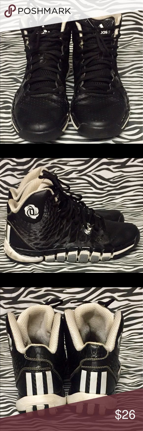 Boys 7.5 Black/White Adidas Hi Tops. Black/White lace up Hi Tops. Little signs of wear on shoes and bottoms. Shoes are in good condition. Adidas Shoes Sneakers
