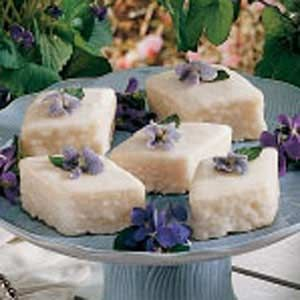 Candied Violets-2 egg whites, 1/2 cup sugar, 6 dozen wild violets (including stems but not leaves), washed.  Editor's Note: Only pick flowers from chemical-free woods or lawns. Also, be sure your blossoms come from the common wild violet, not the   African houseplant, which is inedible.