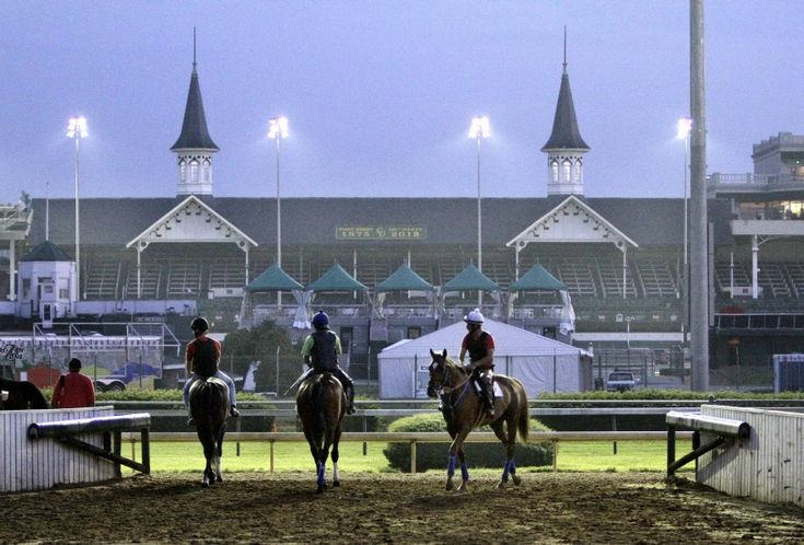 Horses enter and leave the race track in the early morning at Churchill Downs in Louisville, Kentucky.