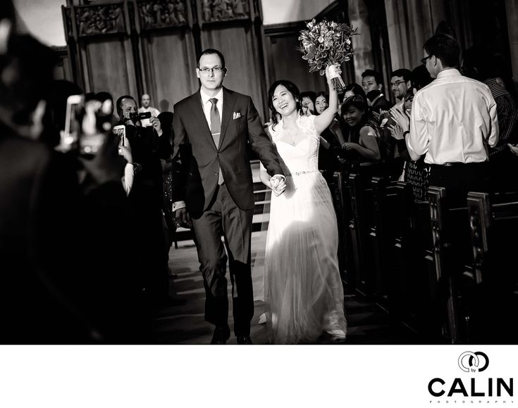 Photography by Calin - Holy Rosary Church Wedding Photographer:  During my career as a Toronto wedding photographer I learned to not only react to events as they unfold but also anticipate them and be ready to capture them. The recessional is such a moment, and I always shoot like a madman the bride and groom exits from the church. In a wedding, the recessional is that inflection point where you switch from a serious and inherently intense format to a more relaxed one. After all…