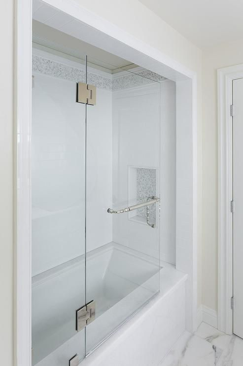 Guest Bathroom Features An Alcove Filled With A Marble
