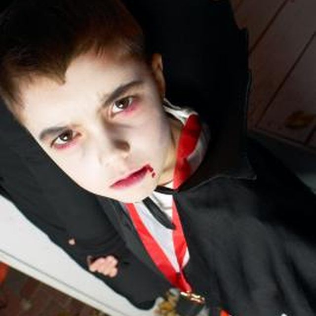 Your child can go as a scary vampire for Halloween with easy-to-apply makeup.