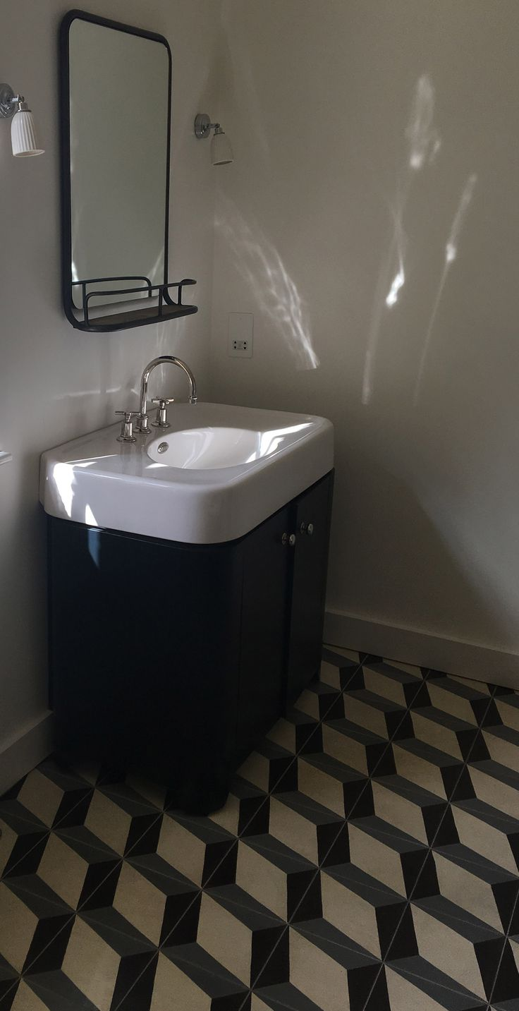another image of the nadia aubergine grey encaustic cement tile utilised beautifully here in our clients bathroom giving it an amazing geometric finish