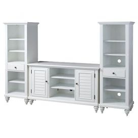 Solid wood entertainment center in white. Includes credenza and two pier cabinets.Product: Entertainment credenza and 2 pier cabinets   Construction Material: Solid and engineered wood     Color: Brushed white     Features: Traditional and coastal designShutter doors and turned feetTwo storage cabinets with two adjustable shelves eachThree adjustable shelves and storage drawerHidden cable access points for neat wire management    Dimensions: 32 H x 56 W x 20 D (center console)