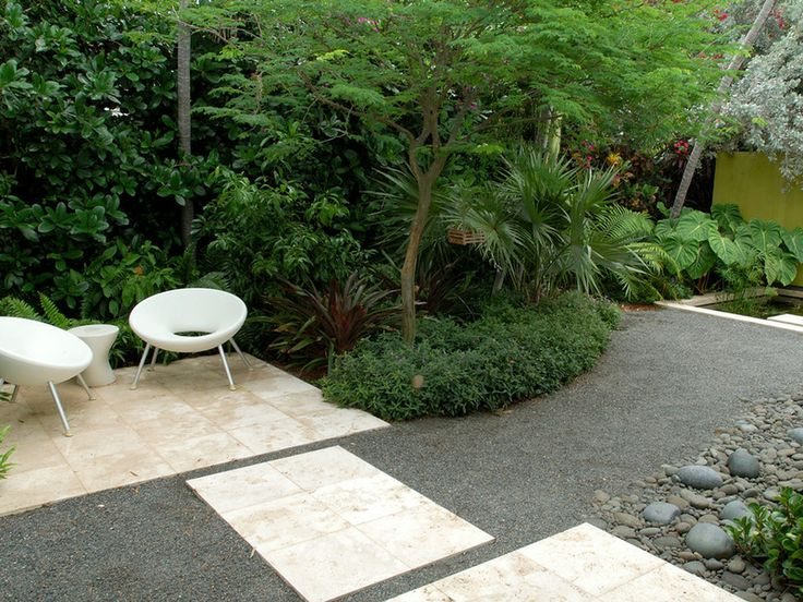 lush plantings and powerful architectural details create impact in a serene place. Not everyone has the budget for beautiful stone and masonry walls, but anyone can start with small plants that will get large and that help manage the space (that is, outcompete the weeds). Seating can be defined with gravel until it can be updated to a possibly more desirable paving material.