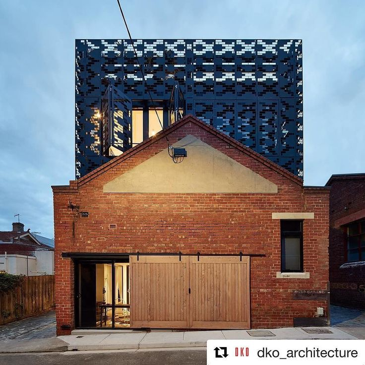 #Repost @dko_architecture  A metal box 'floats' above the existing heritage facade at our 1 Waterloo Street project. The perforated pattern took inspiration from nearby St Jude's Church with openable panels allowing solar access cross ventilation and privacy. . In collaboration with @milieuproperty; built by @milieubuilt; photography by @peterbbennetts  #warehouseliving #adaptivereuse #warehouse #townhouse #industrial #laneway #heritage #architecture #interiordesign #dkoarchitecture…