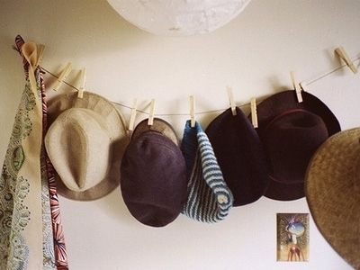 Cute way to display my straw hat collection.
