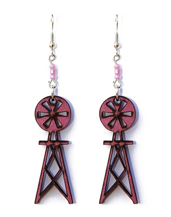 These handmade wooden windmill earrings carry the essence of the South African Karoo. They are pink with black edging and are silver plated (safe for those who are sensitive to nickel).  Made by Dare to Dream, based in the Garden Route of South Africa.  www.handmadeline.co.za