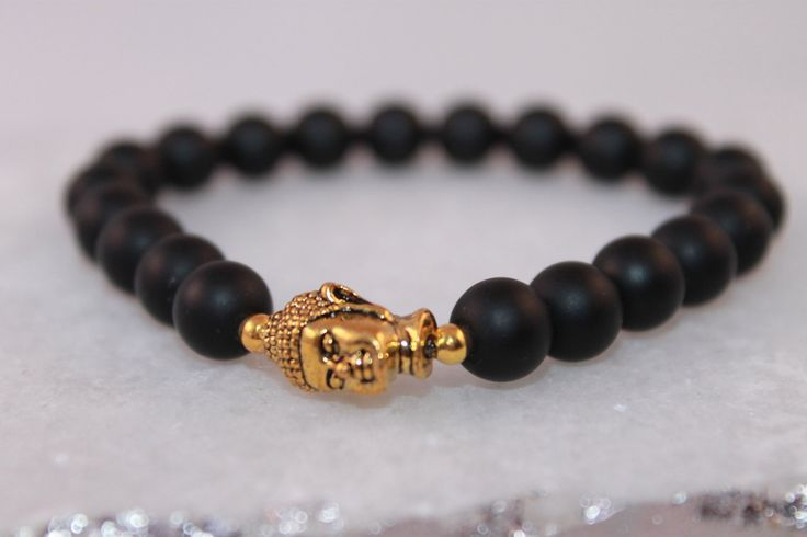 A personal favorite from my Etsy shop https://www.etsy.com/listing/259824476/matte-black-onyx-gemstones-with-gold