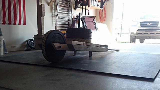 Diy wheelbarrow and sled in training gym