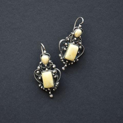Earrings of white amber and open work filigree
