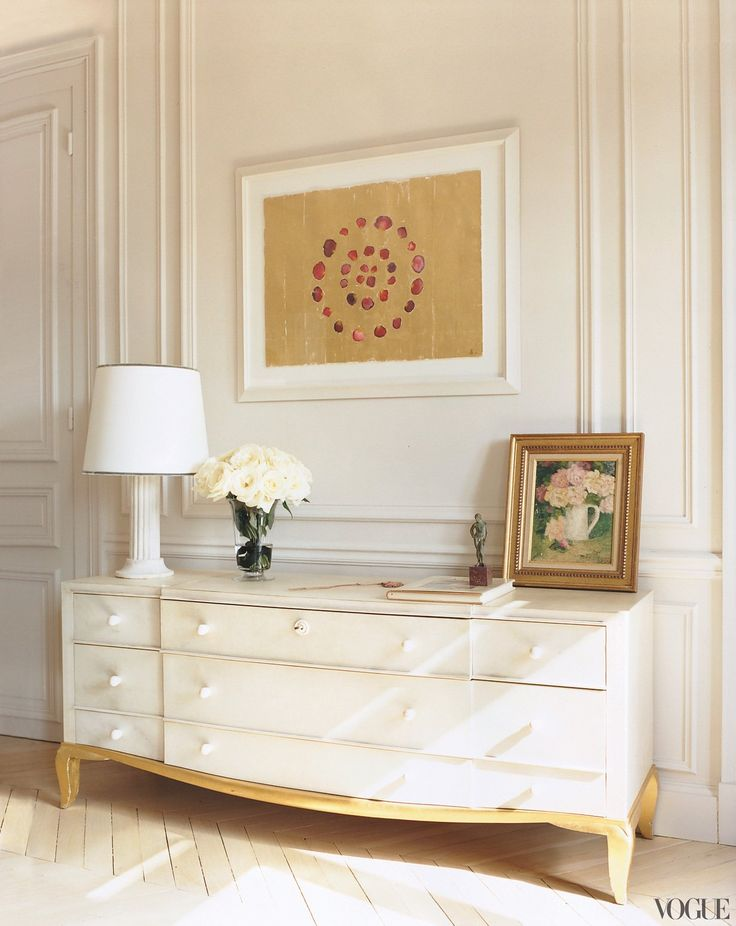 Family Circle - A Jade Jagger watercolor of rose petals in concentric circles is displayed above an armoire by André Arbus.