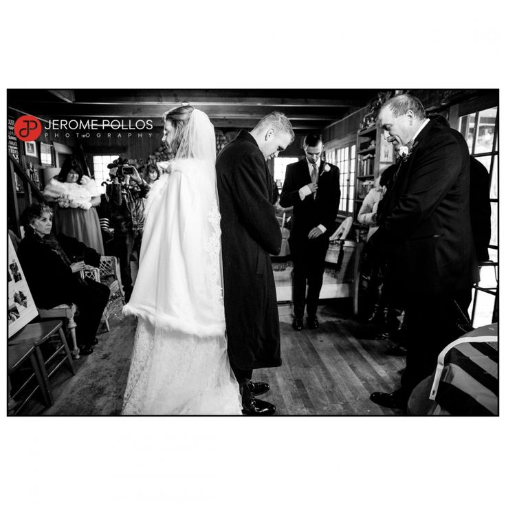 Ensuring they don't see each other before the ceremony, Michaella and Nelson stand back-to-back for a prayer before heading down the aisle. #Documentary #Idaho #Sagle #Wedding #Winter #Bride #Groom #Preparation #Prayer #IdahoPhotographer #IdahoWeddingPhotographer #baileywedding11517 #BlackAndWhite
