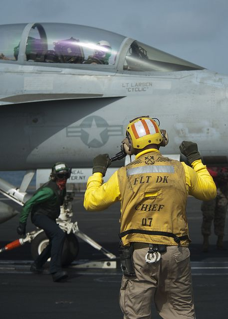 """NORTH ARABIAN SEA (July 19, 2013) Sailors prepare to launch an F/A-18F Super Hornet assigned to the """"Black Knights"""" of Strike Fighter Squadron (VFA) 154 from the flight deck of the aircraft carrier USS Nimitz (CVN 68). Nimitz Strike Group is deployed to the U.S. 5th Fleet area of responsibility conducting maritime security operations, theater security cooperation efforts and support missions for Operation Enduring Freedom."""