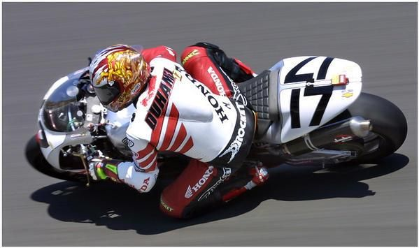 Miguel DuHamel riding the number 17 American Honda RC-51 down through the corkscrew at the WSB/AMA...