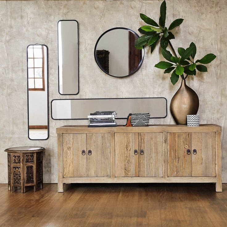 I like the mirrors and the big bronze pot plant. CLIFFORD metal mirror in black D 60cm | Maisons du Monde