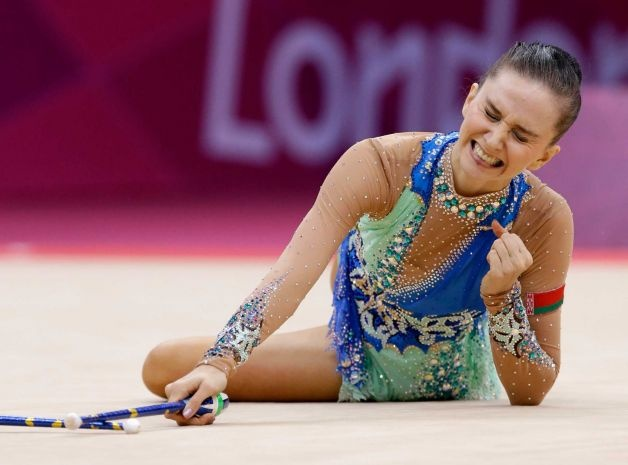 Belarus' Liubou Charkashyna performs during the rhythmic gymnastics individual all-around final at the 2012 Summer Olympics, Saturday, Aug. 11, 2012, in London. Photo: Julie Jacobson / AP