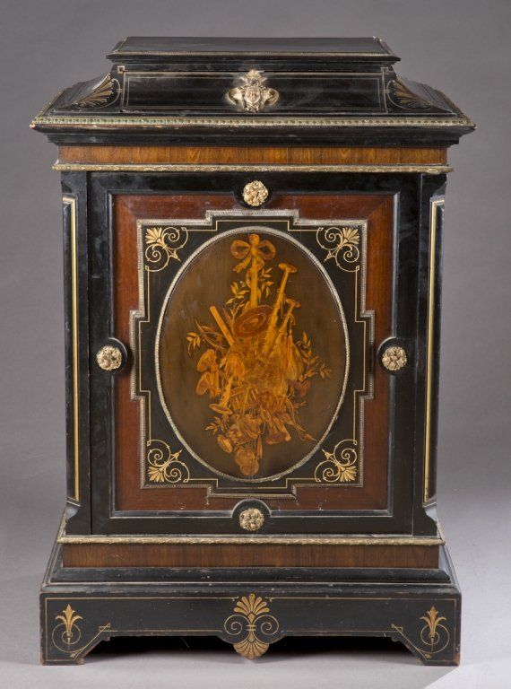 A Napoleon III Style Ebonized Cabinet With Marquetry And Brass Mounts. 19th  Century.