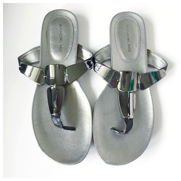 Bandolino Pewter Sandals A great pair of silvery pewter sandals with mirror details on strap. Only worn once, slight scuff on edge of one sandal. Bottoms near perfect condition! True to size Bandolino Shoes Sandals