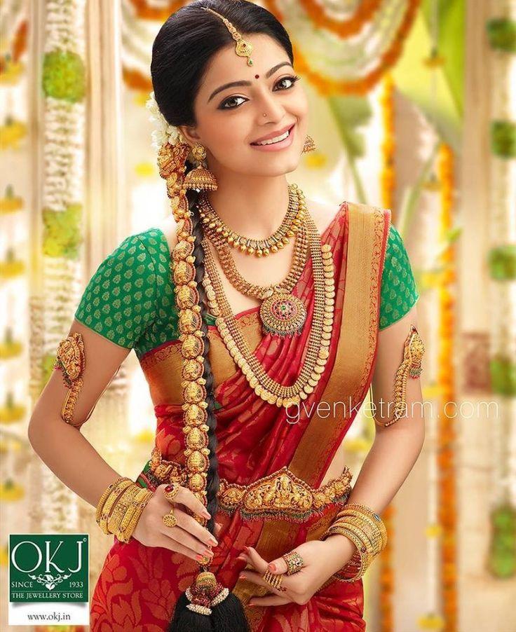 South Indian bride. Gold Indian bridal jewelry.Temple jewelry. Jhumkis.Red silk kanchipuram sari with contrast green blouse.braid with fresh jasmine flowers. Tamil bride. Telugu bride. Kannada bride. Hindu bride. Malayalee bride.Kerala bride.South Indian wedding. Janani Iyer.