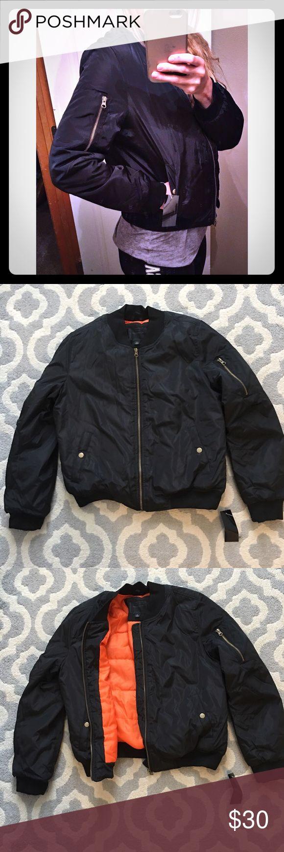 Women's bomber jacket size large NWT New with tags bomber jacket black! Orange inside Jackets & Coats