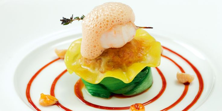 Confit duck-filled ravioli is served with langoustine in this elegant take on surf and turf by Mark Jordan. This recipe is an amazing way to present duck leg.