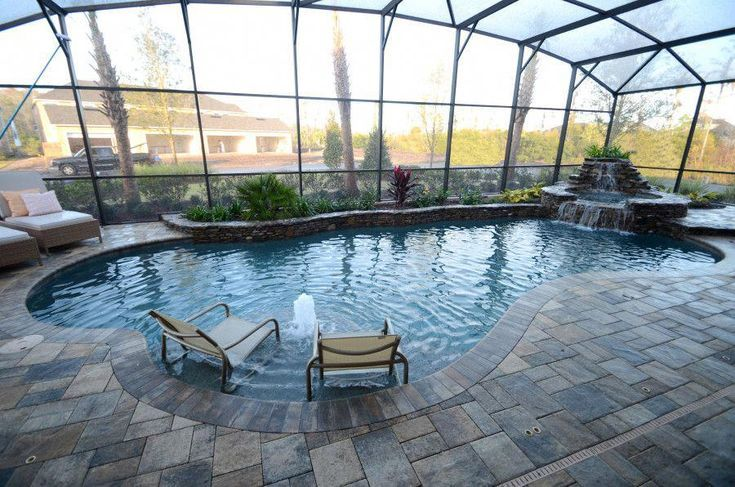 The Pro S And Con S Of Pool Enclosures In Florida Florida Pool Landscaping Around Pool Pool Enclosures