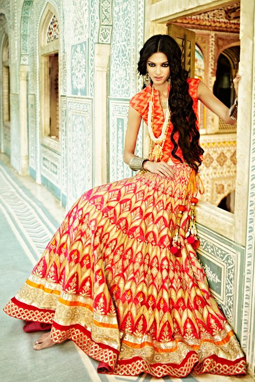 Striking orange & yellow lehenga by Anita Dongre. And man, we wish we had hair like that!
