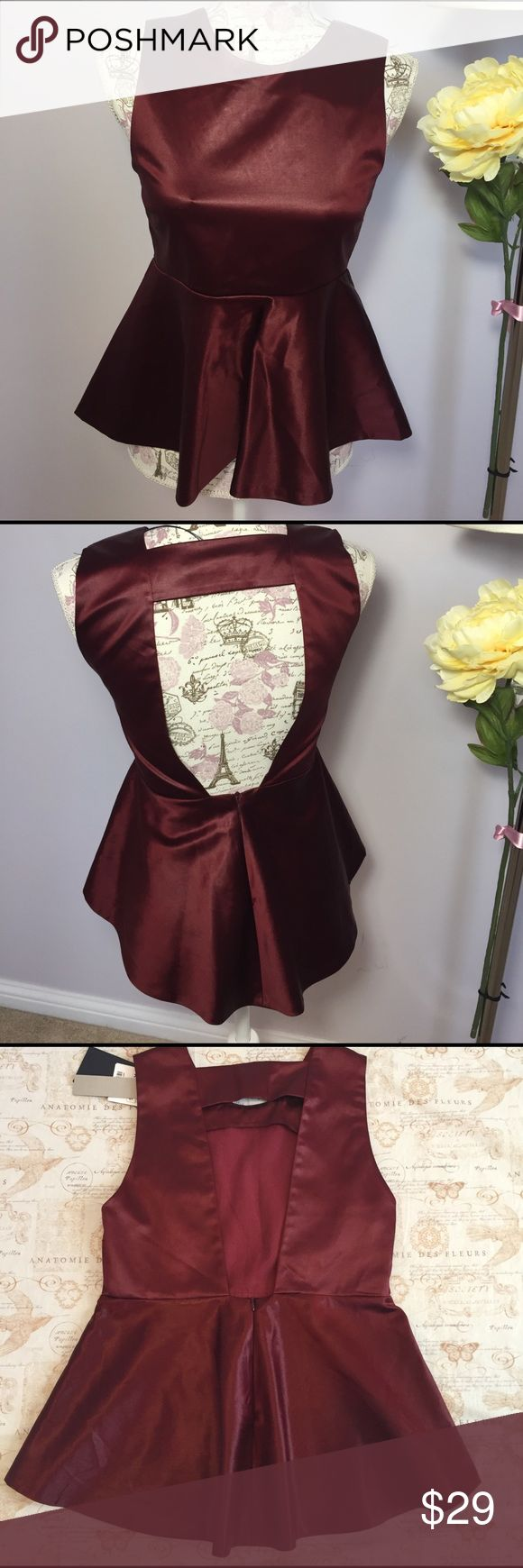 """Zara Studio Peplum Top NWT! Beautiful great quality Zara satin Peplum Top. Burgundy. 52% Cotton, 45% Acetate & 3% Elastane. Exposed High-Low back. Concealed zip for back closure. 15"""" pit to pit. 21"""" shoulder to hem. New with tags. Zara Tops"""