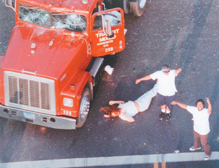 This picture of one of the consequences of the Rodney King trial in L.A. I remember watching live on CNN. It was DEVASTATING to see this caucasion male trucker take a beating at the hands of a number of black kids. These 2 brave men came to the rescue and called for help.
