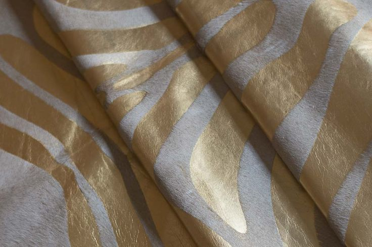 COWHIDE RUG GOLD ZEBRA METALLIC ON WHITE  https://hugohides.com/cowhide-rugs/Metallic-Cowhide-Rug